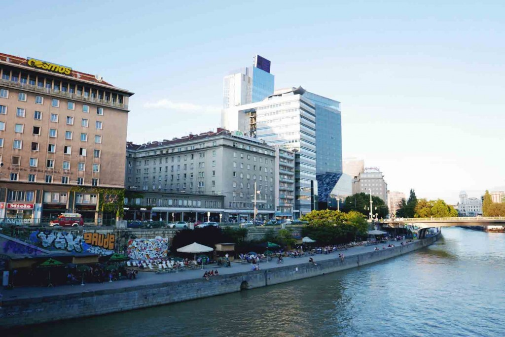 Schwedenplatz / Donaukanal for me is the coolest area I've been in. The canal is so beautiful especially during sunset (which is around 8:30-9pm there). They have cool bars and restaurants there and you can spend hours there doing whatever. It's like a mini beach.